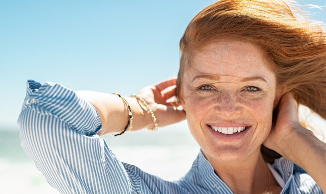 Smiling mature woman at beach